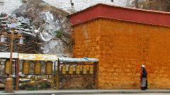 Pilgrims spinning prayer wheels in Tibet Stock Footage