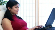 Girl sitting using laptop Stock Footage