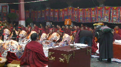 Buddhist monks performing ceremony inside Jokhang Temple Tibet - stock footage