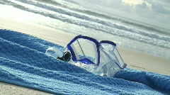 HD: Diving mask on bath towel on the beach Stock Footage