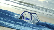 Stock Video Footage of HD: Diving mask on bath towel on the beach