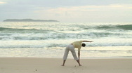Stock Video Footage of HD: Woman doing yoga on the beach at sunrise