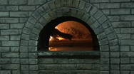 Two clips wood pizza oven and boxed pizza Stock Footage