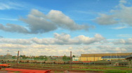 Stock Video Footage of HDR time lapse clip of clouds rolling over industrial train station
