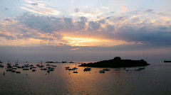 Time lapse sunset over boats Stock Footage