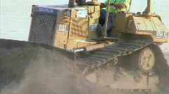 Dozer Clears Edge of Road Stock Footage