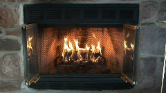 glowing fire in a stone fireplace - stock footage
