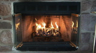 Stock Video Footage of glowing fire in a stone fireplace
