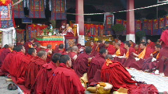 Buddhist monks inside Jokhang Temple, Tibet Stock Footage