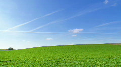 Time lapse of clouds over green hills Stock Footage
