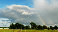 Time lapse of rainbow and storm clouds Stock Footage