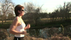 Woman jogging Stock Footage
