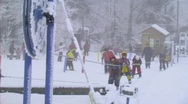 Kids on ski rope pulley Stock Footage