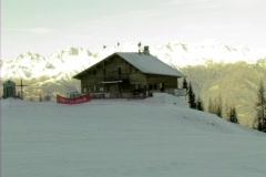Ski lodge with 2 skiers Stock Footage