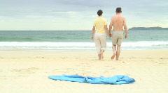 Couple walking on the beach - stock footage