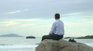 Stock Video Footage of Businessman with mobile phone on the beach