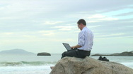 Stock Video Footage of Businessman with laptop on the beach