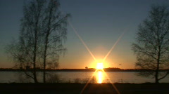 Driving near frozen sea at sunset 1 Part C Stock Footage