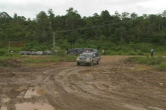Pickup truck goes on muddy road to load onto canoes Stock Footage