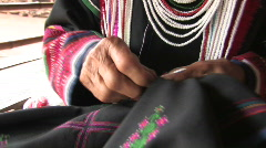 Ethnic Minority woman in traditional dress, sewing in Northern Thailan Stock Footage