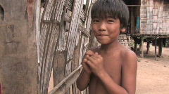 Young boys play shy for the camera in a village in northern Thailand Stock Footage