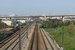Passenger train passing under bridge Stock Footage