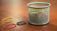 Colored Rubber bands falling onto Office Desktop Stock Footage