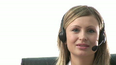 Busineswoman talking on headset - stock footage