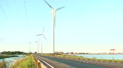 Line of wind power electric stations near the sea 1 Stock Footage