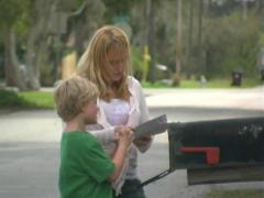 Woman and Child Get the Mail Stock Footage