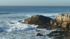 Agitated sea waves against rocks in the beach Stock Footage