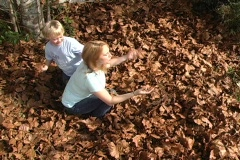 Woman and Child Toss Leaves (5) - stock footage