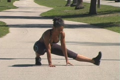 Female Athlete Stretches on Jogging Track Stock Footage