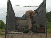 Stock Video Footage of Man organizes wooden planks on truck in Aceh