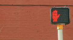 Crosswalk with red brick wall behind it - stock footage