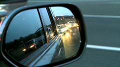Highway travel as seen through a side view mirror Stock Footage