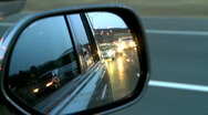 Stock Video Footage of Highway travel as seen through a side view mirror
