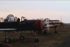 Vintage combat aircraft running for sunset Stock Footage