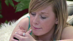 Woman putting on make Up Stock Footage