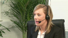 Busineswoman talking on headset Stock Footage