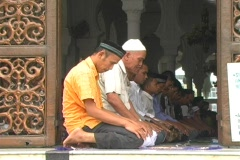 Men praying at main mosque in Aceh Stock Footage