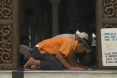 Men pray at main mosque in Aceh, Indonesia - stock footage