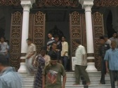 Timelapse men coming out of mosque Stock Footage