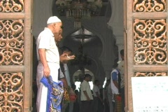 Man fixes prayer mat in main mosque in Aceh Stock Footage