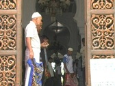 Stock Video Footage of Man fixes prayer mat in main mosque in Aceh