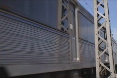 Passenger train passing by Stock Footage