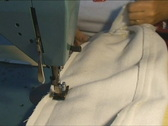 Hands using sewing machine Stock Footage