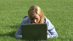 Busineswoman working on computer outside Stock Footage