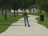 Stock Video Footage of Lovely Young Brunette Rollerblading-1