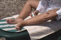 Lady shaving legs Stock Footage